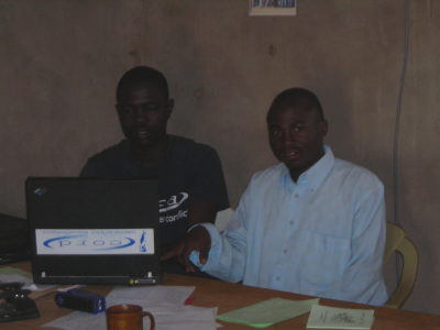 Yacoub helping Taha enter statistics from the villages, Hadjer Hadid, Chad