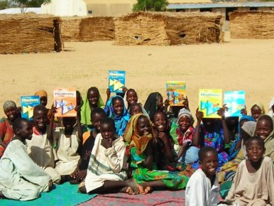 Darfuri children celebrate arrival of English books donated by Book Wish Foundation