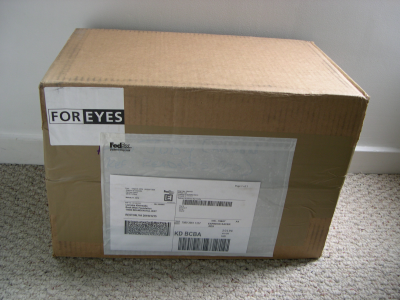 Box of reading glasses from For Eyes