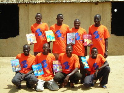 Teachers display their new English books, donated by Book Wish Foundation