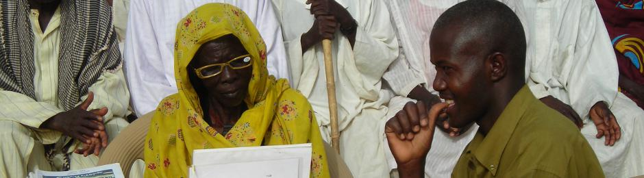 Darfuri woman tested for reading glasses in Bredjing Refugee Camp, Chad